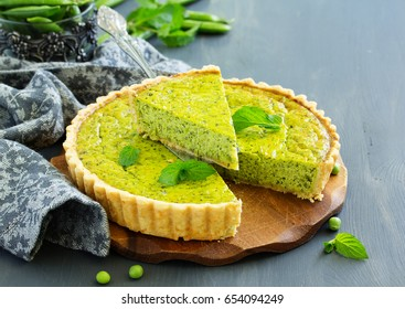 Homemade tart with green peas, bacon and cheese.
