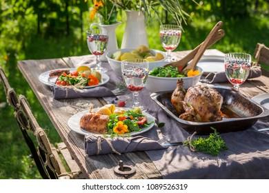Homemade and tasty dinner in summer garden