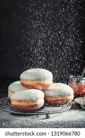 Homemade and tasty donuts on cooling grate