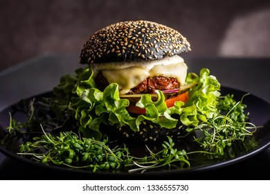Homemade tasty hamburger with beef, cheese and caramelized onions.