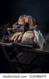 Homemade and tasty loaf of bread on old slicer