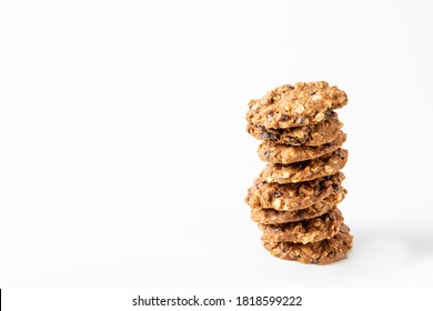 Homemade tasty oatmeal cookies with raisins, dried cranberry and Himalayan mango seeds. Healthy snack concept. Sweet dessert. Space for text.