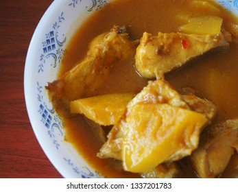 Homemade Thai Food: Spicy and sour soup made of tamarind paste with fish fillet and pineapple slices