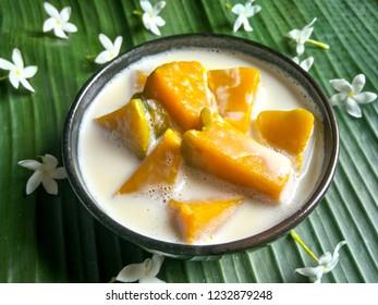 Homemade Thanksgiving desert : Pumpkin with coconut milk, sweet and nutty with cream coconut milk,tender pumpkin texture, Desert to make you warm in winter.