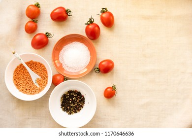 Homemade tomato sauce in glass jar with fresh tomatoes, garlic, onion, herbs and spices