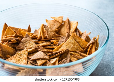 Homemade Tortilla Chips made with Flatbread in Glass Bowl and Baked in Oven