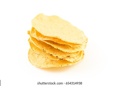 Homemade tostada shells on a white background.