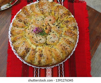 Homemade traditional Balkan pastry dish Pogaca with black caraway and sesame seeds. Homemade traditional Balkan pastry dish. Cuisine, caraway.