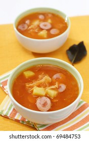Homemade traditional cabbage soup made from sauerkraut, potato and meat sausage
