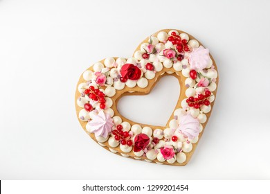 homemade trendy heart shaped naked cake for Valentines Day, white background, top view