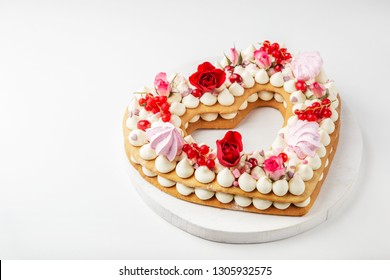 homemade trendy heart shaped naked cake for Valentines Day, white background, selective focus, copy space