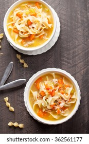 Homemade Turkey Noodle Soup vertical shot top view