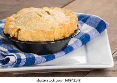 Homemade turkey pot pie on a white plate