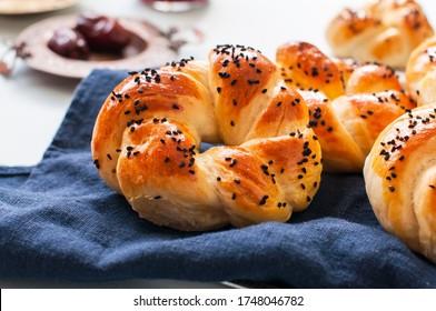 Homemade turkish bagel pogaca with nigella seeds. Freshly backed swirl buns.