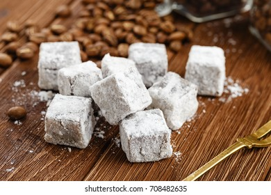 Homemade turkish delight with powdered sugar on wooden background. Rahat lokum recipe