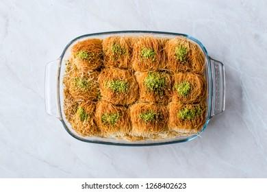 Homemade Turkish Dessert Fincan Kadayif Baklava / Baklawa with Pistachio Powder.