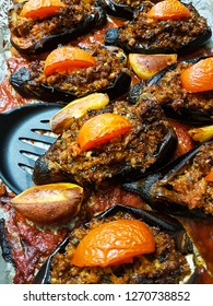 Homemade Turkish Karniyarik (Riven Belly), a traditional dish in Turkish cuisine, eggplants stuffed with ground vegan beef replacer and vegetables, baked in oven with tomato sauce