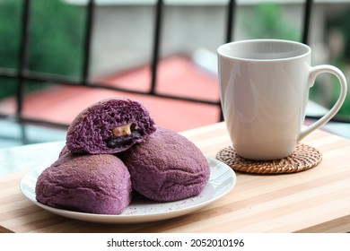 A homemade Ube bread with yam and cheese filling.