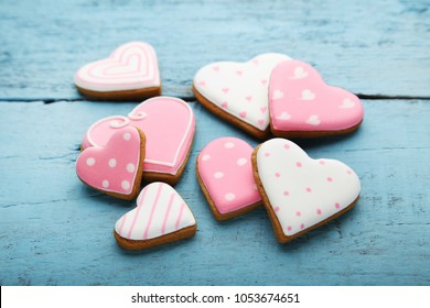 Homemade valentine cookies on blue wooden table