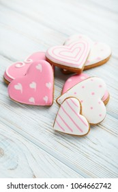Homemade valentine cookies on wooden table