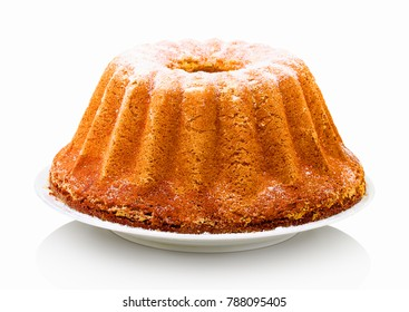"Homemade vanilla bunt cake on white ceramic cake plate. Sweet marble cake in slovak called ""babovka"", isolated on white background with shadow reflection.  Cake in Dutch called ""tulband""."