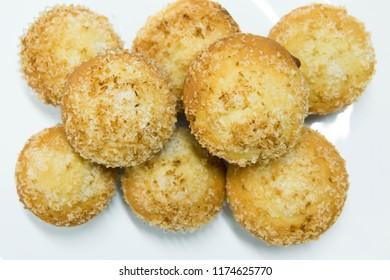 Homemade vanilla muffin with coconut powder background