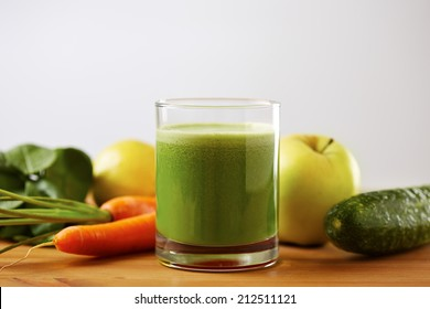 Homemade vegan green juice with fruit and vegetables