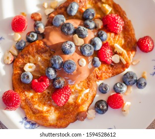 homemade vegan pancakes and strawberries and blueberries