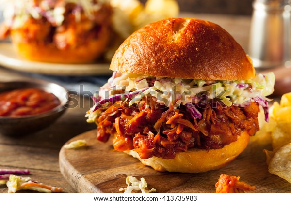 Homemade Vegan Pulled Jackfruit BBQ Sandwich with Coleslaw and Chips