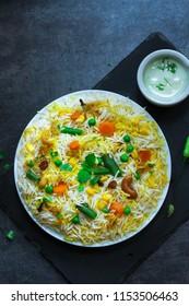 Homemade Vegetable Biryani / Veg Pilaf or Pulao overhead view