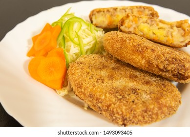 Homemade vegetable poak croquettes with salad, minced Poak, potato and carrot in the croquettes.