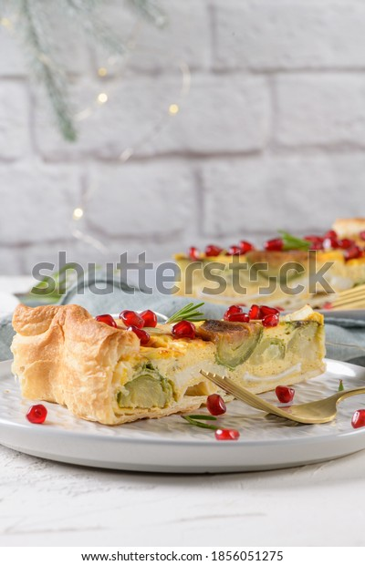 Homemade vegetable quiche with goat cheese, brussels sprouts and pomegranate seeds.
