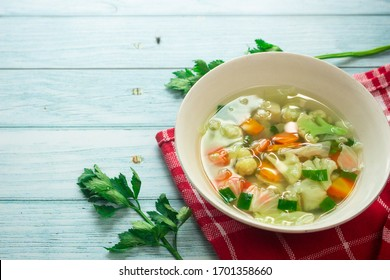 Homemade vegetable soup, overhead, close up view on an old wood background