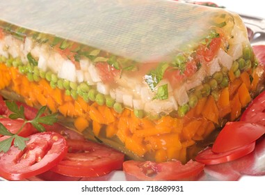 Homemade vegetable terrine in front of white background