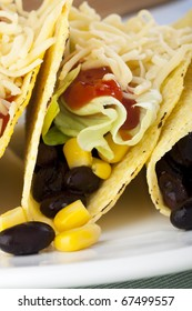 Homemade vegetarian tacos with black beans and sweet corn.