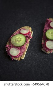 homemade veggie sandwich with cucumber, garden radish and beetroot dip