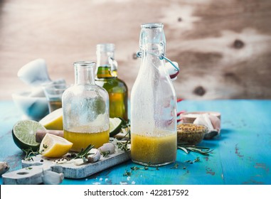 Homemade vinaigrette and ingredients, salad dressing with oil, vinegar and mustard, rustic style