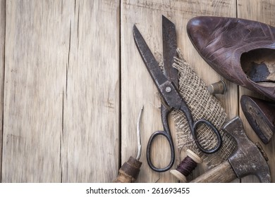 Homemade vintage tools on a wooden background with space for text