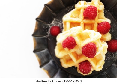 Homemade waffle and raspberry for breakfast image
