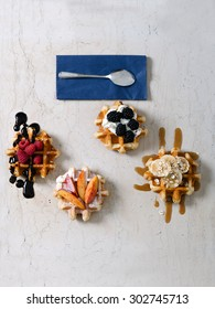 Homemade waffles whit fruits on vintage table. Selective focus and small depth of field.