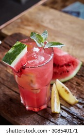 Homemade watermelon lemonade with mint and lemon in glasses and slices of watermelon