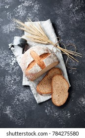 Homemade whole wheat bread on a grey background, selective focus