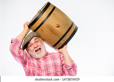 Homemade wine. Man bearded senior carry wooden barrel for wine. Fermentation product. Retro man with a beer barrel. Barman. wooden barrel. oktoberfest festival. brewery for maturing alcohol.