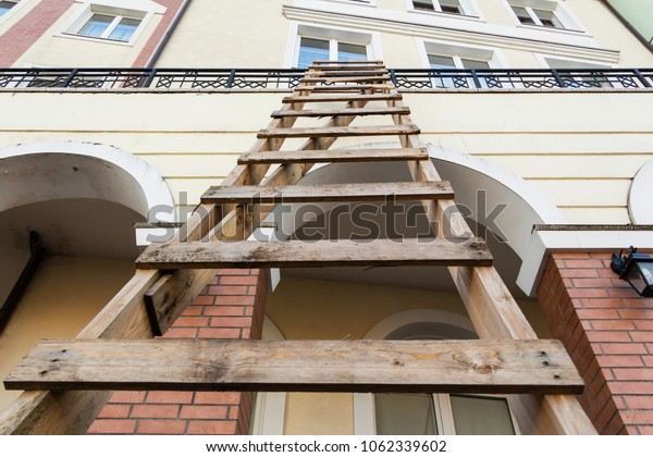 Homemade wooden staircase leading to the roof. The concept of growth and development.