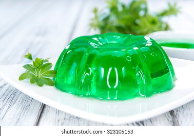 Homemade Woodruff Jello (on a bright wooden background)