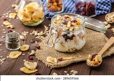 Homemade yogurt with granola, dried fruit and nuts bio - cia seed - most healthy seed, apricot and banana dried fruit