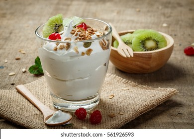 Homemade yogurt with granola, kiwi, dried fruit and nuts bio with most healthy seed.