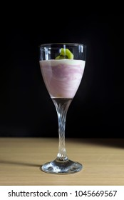 Homemade yogurt with kiwi fruit, pears and berries in a glass