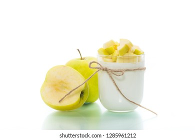 homemade yogurt with ripe apples isolated on white