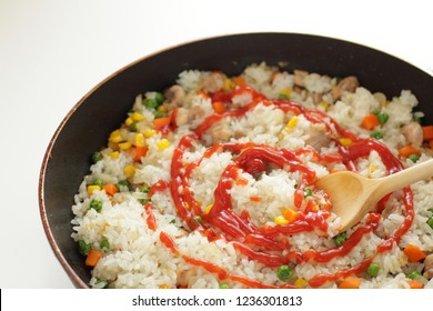 Homemdae chicken and ketchup rice on frying pan